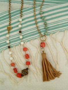 ExVoto Vintage Jewelry. Vintage coral, African bead, mother of pearl and leather tassel.
