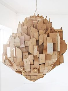 In need of some out-of-the-box artistic inspiration? Swedish artist and illustrator, Nina Lindgren, has more than just a way with cardboard -- her Floating City cardboard sculpture is a thought provoking work of art. Cardboard City, Cardboard Sculpture, Cardboard Paper, Art Sculpture, Cardboard Crafts, Paper Crafts, Cardboard Houses, Mr Printables, Instalation Art