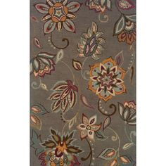 This beautiful hand-tufted area rug features a large scale floral motif in grey, blue, purple, orange, green and brown. With its distinctive looped wool construction, this area rug will give your space a sense of warmth and comfort.