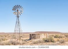 A typical rural Karoo scene in South Africa - a water pumping windmill with a leaking dam Royalty Free Images, Royalty Free Stock Photos, Landscape Paintings, Landscapes, Better Day, Windmills, Pumping, Skeletons, Animal Paintings