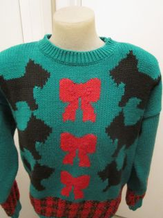 Vintage Scotty Dog Ugly Christmas Sweater This has it all Dogs Bows and Plaid Sure to be a crowd pleaser. $25.00, via Etsy.