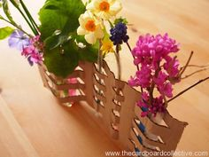 How PERFECT for all those little flowers my baby boy brings that are too small for the vase! Woven Cardboard Vase DIY by The Cardboard Collective