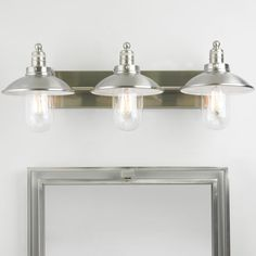 Schooner 3-Light Bath Light This 3-light vanity light will complement nautical-themed or industrial-inspired bathroom decor. Available in Brushed Nickel finish with clear glass bulb covers.
