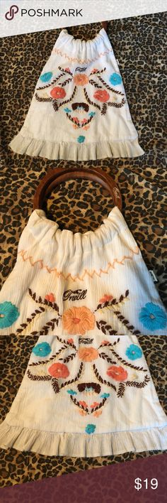 Boho wood handle Oneill floral embroider handbag Great condition- only carried once! Unique!! Love this purse! A white thin textured cloth with neat colored embroidered /stitched flower type design, a pretty ruffle @ the bottom  & an awesome wooden handle (approx. 5 in. Drop) just helps make the purse! Without the ruffle added the actual purse measures approx. 11.5 in. Long & approx. 12.5 in @ its widest point. Made by Oneill this is a thinner light, daintier longer purse! Pretty & unique…