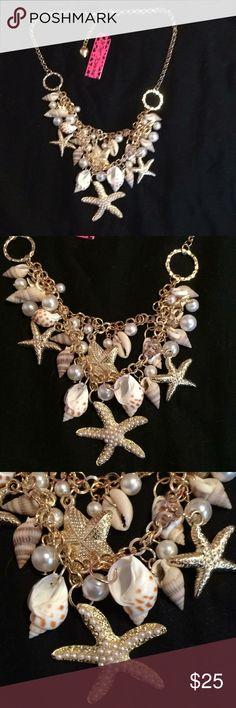NWT Betsey Johnson Sea Shell 🐚 necklace. NWT Betsey Johnson Sea Shell 🐚 necklace. Seashells, pearls, and starfish make up the necklace. Gold plated chain measures proximately 20 inches long. Great summer necklace. Betsey Johnson Jewelry Necklaces