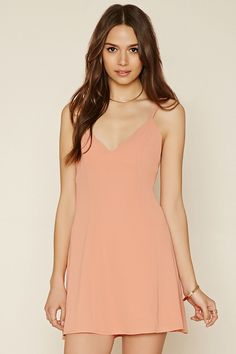 Forever 21 Contemporary - A knit dress with dual cami straps that lace-up at the back, a subtle flared hem, a concealed back zipper, and a V-neckline.