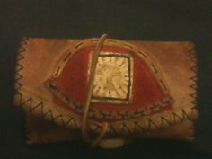 Hand made tabacco punch from leather and wood with pyrografy. Theme Tree
