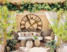 outdoor lounge - oversized clocks, wicker stools