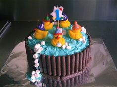 Claire Waring of @Craft Schmaft created this rubber ducky cake based on the AWW swimming pool cake