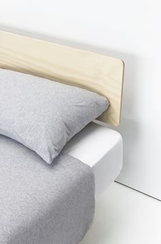 $700 AUD single$950 AUD double$1000 AUD queen$1100 AUD kingBlack/white headboard +$100Plywood headboard +$200Click to order by email *Please note a modest price rise will occur early in 2017.— A simple bed base you can put together in minutes without tools. The mattress 'floats' on the minimal base – perfect if you've got a small room and need to maximise floor space. When the base is dismantled it can be carried by one person and will fit into lifts and most small cars. The...