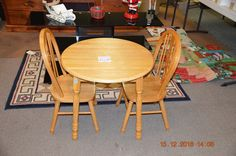 Solid Oak Kid's Table and 2 chairs.