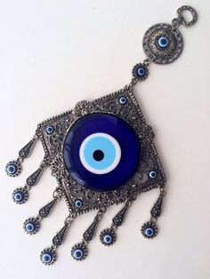 Evil eye protection - evil eye wall hanging - blue glass decor - good luck charm - wall decal - home decor judaica by UrbanJewelleryShop on Etsy