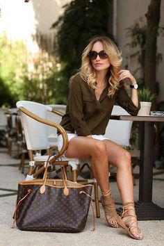 brown shirt, white short- louis vuitton neverfull bag