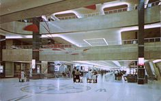 "Vintage postcard of an inside view of the Greater Pittsburgh Airport in Pittsburgh, Pennsylvania. Shows people, three levels, the compass directions on the floor and a mobile sculpture hanging from the ceiling. ""Color"" by Carl Scholfield. Photo Postcards, Vintage Postcards, Pittsburgh International Airport, Pennsylvania History, Pittsburgh Pa, Air Travel, Mid Century Modern Design, Vintage Colors, Mid-century Modern"