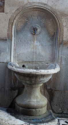 Public drinking fountain, Rome; note the SPQR engraved at the top.