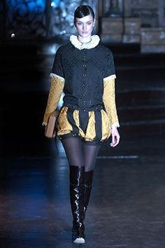 Sebastian Pons-Fall 2004 ready to wear: wide paned trunk hose, ruff, button down bodice, hair pulled back