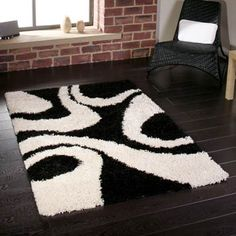 This striking abstract rug design with a luxurious 5cm shaggy pile is available in a stylish monochrome colourway.    The contemporary pattern in black and white is perfect for adding a dramatic look to a living space.