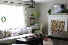 Behr Castle Path paint, Ikea Hovas sofa, faux fireplace with stacked wood birch logs via www.goldenboysandme,com