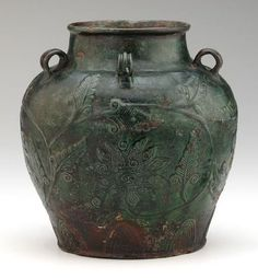 Zhangzhou ware jar with five loop handles and relief floral vinescroll decoration, 16th century Ming dynasty, Stoneware with copper-green lead-silicate glaze