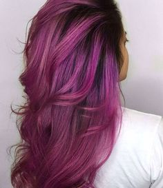 Rooted vivid magenta purple pink hair color.