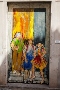 Opportunity is knocking for the three young girls painted on this door in Madeira, Portugal