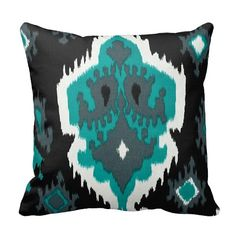 Love this!  It's the style mom likes but ties in all the colors including the sofa!  Teal White Black Geometric Ikat Turquoise by PrimalVogueHomeDecor
