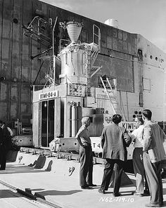 The Director of the Los Alamos National Laboratory, Norris Bradbury (left) in front of the Kiwi B4-A reactor
