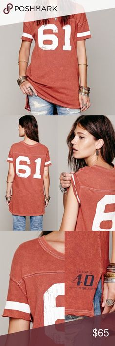 """RARE Free People We The Free Little League Tee Rare & much sought after Free People Little League Tee in Spice. In EUC. Last photo shows actual top being sold. """"Distressed wash tee with numbers graphic on front and back. Exposed seam and raw edge hem. Slight hi-low with slits at each side. Each piece is special and unique so level of distressing may vary slightly between each item. Color: Spice Combo"""" Free People Tops Tees - Short Sleeve"""