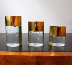 Mid Century glass and brass candleholders designed by Rune Strand for Nybro Sweden c 1970s from MidCenturyFLA