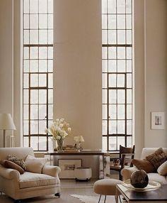 floor to ceiling windows, neutral interior