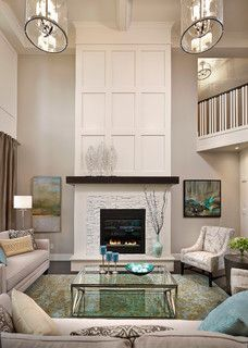 love this fireplace, off-white paint, with stone tiles and dark wood ledge, nice molding above too.