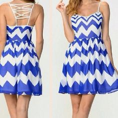 """HP! Chevron dress Beautiful blue and white chevron dress. Fully lined. Awesome, strappy back detailing and zip up side. A classic fitted bodice and flared skirt creates a feminine feel, while crisscrossed detailing in back lends visual interest to your look. 100% polyester. Bust - 35-36"""" waist 27-28"""" hip 37-38"""" MOON Dresses"""