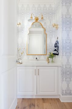 Beachside Boho – lark & linen | fresh neo-traditional bathroom | love the wallpaper and gold accents #blueandwhite