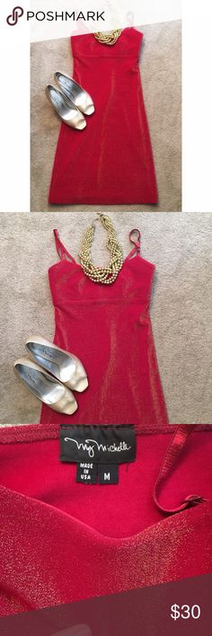 "My Michelle Holiday Party Dress Gorgeous Red and Gold Glitter Holiday Party Dress • This dress is meant to hug the body and is made of thick nylon and spandex. The straps are adjustable. It has an empire waist. The length of the skirt from the empire waist hem is 27.5"". It is a beautiful dress that shimmers in the light. • Never worn. My Michelle Dresses Midi"