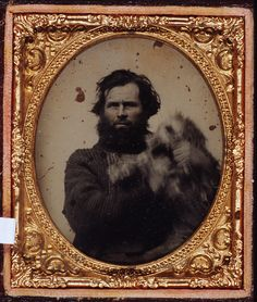 Historical Indulgences ca. 1870s, [ambrotype portrait of a man struggling to contain his wriggling dog]  via the George Eastman House Collection, acc. no. 69.0205.0014