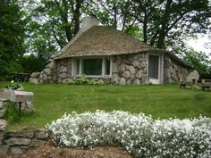 check out my house-peeping tour of the Mushroom Houses in Charlevoix, Michigan - http://www.house-crazy.com/house-peeping-earl-young-homes-in-charlevoix-michigan/