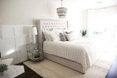 Clean and cozy, this all white bedroom layers textures to achieve its inviting, yet chic look!