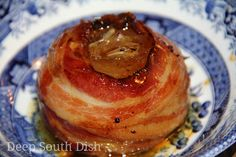 Baked Vidalia Onions - Sweet Vidalia onions, stuffed with garlic and butter and drizzled with balsamic vinegar, is wrapped in bacon and placed in individual packets to be cooked on the grill or oven.