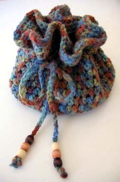 Drawstring Crochet Bag: free pattern  Great for wrapping up a small little gift.....two gifts in one!