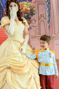 Even Princess Belle cannot handle all the cuteness of this little Prince Charming