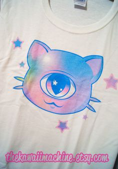 This shirt features an adorable Mewclops original illustration :).  A pastel kitty ready to stare into the souls of onlookers on a 100% cotton women's tee.  These shirts are custom printed to order, so please allow about a week for production and shipping :).