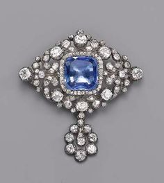 AN ANTIQUE SAPPHIRE AND DIAMOND BROOCH The central cushion-shaped sapphire within old-cut diamond border to the floral diamond surround and detachable cluster drop, mounted in silver and gold, circa 1870, 5.3 cm. long