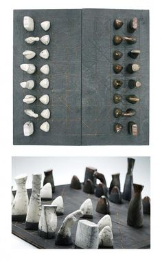 Ceramic chess pieces, set out on this intriguing board of black burnt plywood, will bring a mystical stone age appeal to any space–perfect f...