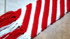 Oh what fun (and easy) it is to crochet a Candy Cane Scarf (@ Crafts by Starlight)
