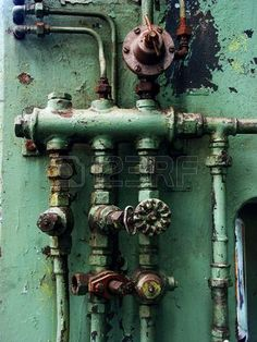 Old rusty pipes and valves with water leaks Stock Photo