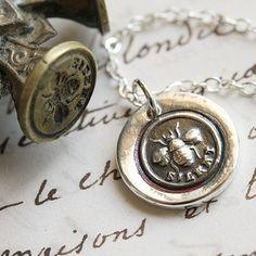 Embossed bee earrings