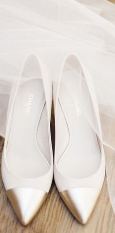 Chanel gold and white wedding shoes   Pinned from http://www.stylemepretty.com/ via judith   #WeddingShoes #GoldShoes