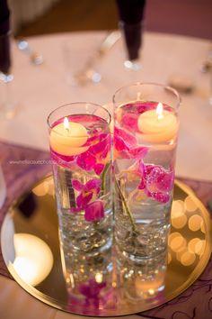 Centerpiece Designed With Jewel Tone Blooms Garden Roses Lisianthus Safari Sunset Succulents Arranged Into An Oasis Ring Succulent Wedding Ideas