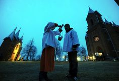 Belarussian Catholics prepare for a procession celebrating Easter in the small town of Ivenets on April 8, 2012.