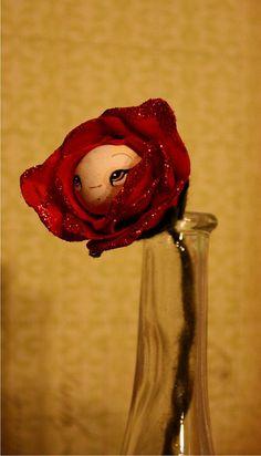 rose paper mache doll